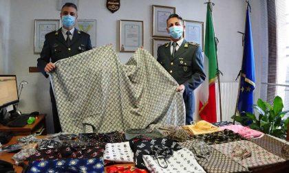 Sequestrate mascherine e tessuti con marchi contraffatti e decorazioni di Carnevale pericolose